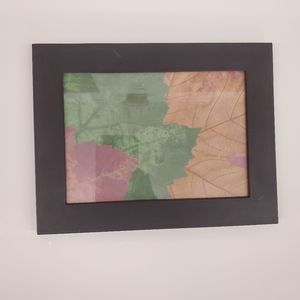 Picture frame with decorative paper leaves display